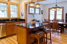 Destination Spot for Growing Family: After from this old houses Best Kitchen Before and Afters 2013 - taking own a wall to open a kitchen to dining room