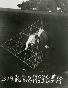 Alexander Graham Bell and Mabel  kissing within a tetrahedral kite  October 1903