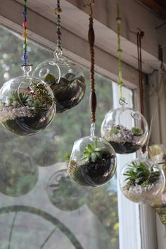 96% recycled Hand Blown Glass Globe with Custom Purple Stone Hanging Chain. $15.00, via Etsy. Hanging Glass Terrariums