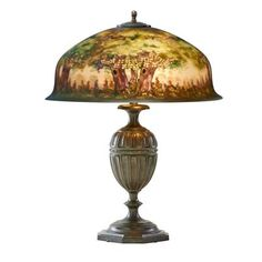 """PAIRPOINT - Table lamp, Berkeley shade with forest scene on fluted base, Bedford, MA, 1910s-20s Acid-etched reverse-painted glass, patinated metal, two sockets Shade with The Pairpoint Corp'n gold mark, base stamped PAIRPOINT D3038 MADE IN U.S.A 23"""" x 17 1/4"""""""