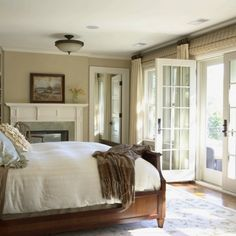 Simple Bedroom. Bed facing French doors.