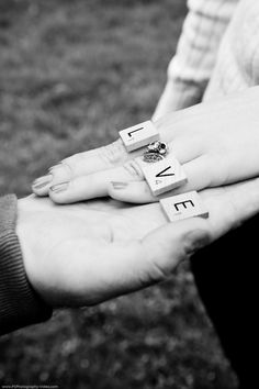 LOVE scrabble letters on hand for engagement photo, using the ring as the o- photo by Seattle and Los Angeles Wedding Photographer, Trina with PS Photography.  LIKE at http://www.facebook.com/WeddingPhotographyandVideo and check out the site at http://psphotography-video.com