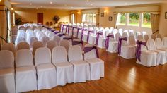 The Danube Suite at Hungarian Hall setup for a wedding ceremony with covered chairs