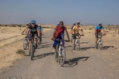 Pedal this way! Isaac led the first group of cyclists to venture on the…