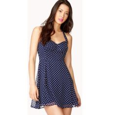 Forever 21 Polkadot Halter Adorable F21 halter dress, perfect for July 4th! • navy blue w/ white polkadots • tie around neck • zip up back w/ clasp • lined Forever 21 Dresses
