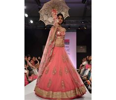 Buy Bollywood Replica Lakme fashion model net lehenga in peach color in Mauritius, Fiji, Australia, UK, USA and Canada through online shopping. This bollywood lehenga comes with the worldwide free shipping offer