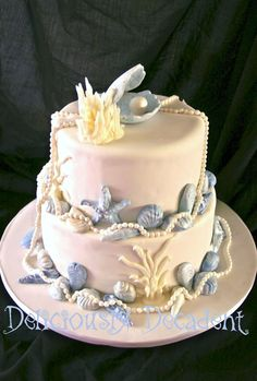 Under The Sea Beach Wedding Cake. If you want the best officiant for your Outer Banks, NC, ceremony, contact Rev. Barbara Mulford: myobxofficiant.com/