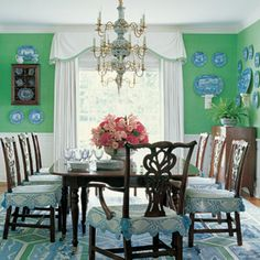 Green Dining Room: A cheeky green like Leprechaun Green 557 from Benjamin Moore lends a sense of humor to the dining room.