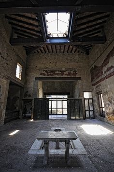 Herculaneum atrium with intact compluvium (hole in the ceiling for rain) and impluvium (porous rock basin that collected the rain water and filtered it into a cistern)