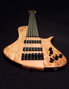 Top Spalted Maple  Neck  Maple  Fretboard  Ebony Macassar  Nordstrand Walnut Body  Pickups  Aguilar OBP-3  24 frets
