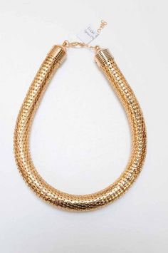 Bendy gold-tone 'pipe' necklace.  Lush Boutique.