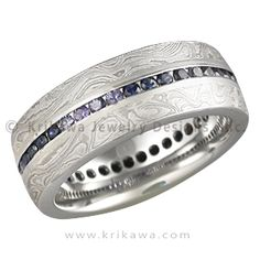 Mokume Diamond Channel Center Wedding Band with Blue Sapphires - This is a mokume wedding band and a diamond eternity ring in one. Designed for men, but great for women also. A most unusual combination. Priced for 1.5mm ideal cut diamonds. 7mm wide.   - This handcrafted wedding band is set with blue sapphires and inlaid with Platinum mokume.