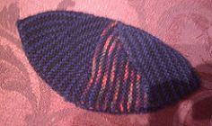 I call this the Minyan Kippah as it is a quick knit, so I could make enough to give them as gifts to all the members of the minyan, yet it produces a fine enough fabric to be a dress kippah.