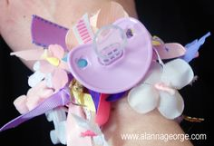Ribbons and a pacifier make a cute wrist corsage for mommy-to-be. Check it out, so easy to do! #DIY #Baby #Crafts
