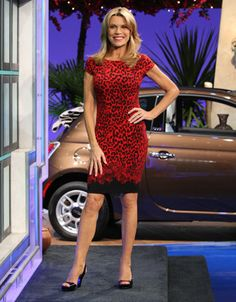 CACHE: Red & black abstract animal print cocktail dress, scoop neckline, short sleeves, straight skirt w/solid black hemline | Vanna White's dresses | Wheel of Fortune