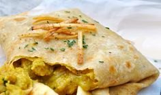 Indian Chicken A West Indian style curry Trini Roti from the deepest regions of the Caribbean, Uncle Kalo's Trini Roti.A West Indian style curry Trini Roti from the deepest regions of the Caribbean, Uncle Kalo's Trini Roti. Carribean Food, Caribbean Recipes, Caribbean Chicken, Trinidad Chicken Roti Recipe, Chicken Curry Roti Recipe, Trinidad Roti, Recipe Chicken, Trinidad Curry Chicken, Chefs