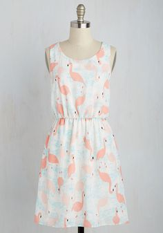 The pep you'll receive from this printed sundress will have you ready for whatever's tossed your 'wade'! Standing in soft blue water, light pink flamingos bedeck breezy white chiffon, giving this pleasant frock formidable energy!