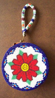 Native American Beadwork,  Beaded Coin Purse or Pouch, Leather, Zippered With Handle Floral Rosette. $105.00, via Etsy.