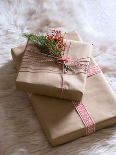 Sprigs of rosemary and pepperberry perk up presents wrapped in kraft paper.