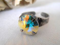 Aurora Borealis, Swarovski crystal Ring, Rivoli 12mm, Adjustable Rings, Antique Silver, prong setting, Costume/Fashion Accessories #FashionRings #ProngRing #Rivoli12mmRings #SwarovskiRing #SwarovskiRings #AuroraBorealisRing #AbRings #rings #AdjustableRings #CrystalRings Bridal Cuff, Pearl Cufflinks, Swarovski Crystal Rings, Crystal Shapes, Aurora Borealis, Silver Cuff, Stones And Crystals, Fashion Rings, Antique Silver