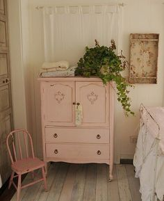vintage pink cabinet . I am going to paint a piece of furniture in my bedroom this color. I love it :)