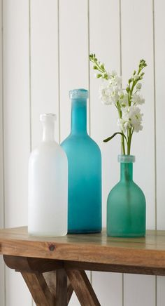 Fill this artful trio of frosted Seaglass Bottles with flowers or branches, arrange them on a mantel or a table, and your gaze will be taken out to sea.