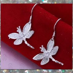 Dragonfly Dangle Earrings Silver plated dragonfly dangling earrings. How cute!! Dragonfly myths, legends & folklore are abundant all over the world. New. No Trades, No PP. Price Firm. @beautyshineson     *no brand* Jewelry Earrings