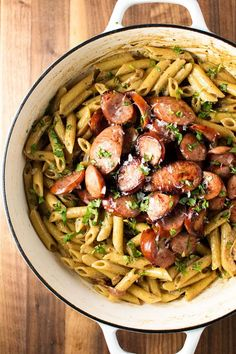 Pan seared kielbasa with a creamy mustard pasta made with white wine, butter, cream, and Parmesan cheese.
