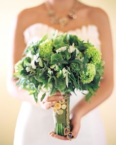 Greenery reigns supreme in this bouquet of mint, hellebores, ranunculus, and parrot tulips, adorned with the mother-of-the-bride's locket.