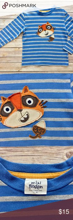 Mini Boden: Blue Stripped Squirrel Shirt Mini Boden   Size: 5/6  Blue stripped squirrel appliqué long sleeve shirt,  in very good condition. This shirt has some wash wear. This shirt ran a little small for us. I would purchase for a size 5.   This item has plenty of life left in it to be enjoyed again. My son outgrew it quickly so it's been sitting in our closet. Please refer to pictures for reference.  I will package perfectly and with love.  From a non-smoking home. Mini Boden Shirts…