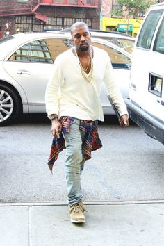 Kanye wearing off white Rolf Lauren hanely , distressed blue jeans and vizvim sneakers