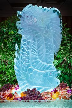 Beautiful ice sculpture by Sirata's own, Chef Luis. #icecarving