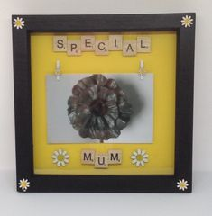 """Wooden scrabble letters on a yellow background saying """"Special Mum."""" With hand painted wooden daisy flowers. Two wooden daisy pegs to hold a inch photo. Photo for demonstration use only. Frames are black, wooden, inches. Scrabble Letters, Mothers Day Presents, Yellow Background, Daisies, Gift Guide, Hand Painted, Frame, Picture Frame, Margaritas"""