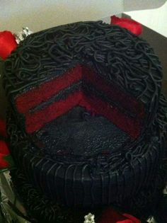 Red velvet wedding cake with black icing. I'm not crazy about how the icing is designed... I think deep red roses on the black would be much more romantic, as it is a wedding after all.
