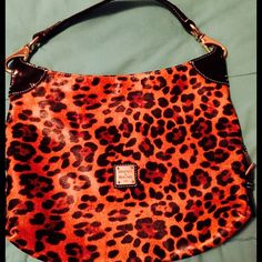 Dooney & Bourke Leopard Purse Dooney & Bourke Leopard Purse possibly one of the most beautiful purses I have ever owned! Yes it is gently used however I handle my things with lots of love and care Dooney & Bourke Bags