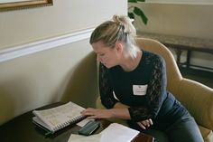 Holly Austin Smith, a former sex-trafficking victim and current advocate, looks over a list of other survivors in a notebook she carries with her after speaking Wednesday in Charleston.