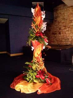 Pentecost flower arrangement- red/orange symbolizing fire and white doves the Holy Spirit.