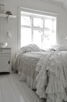 White bedroom with contrast of natural bed cover, lots of ruffles - white wood floor, wood walls, furniture and furnishing