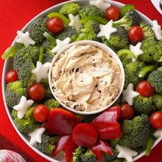 Vegetable Wreath with Dip Recipe -Vegetables and dip are a mainstay at most holiday parties. I like to dress up this appetizer by cutting vegetables into festive shapes and arranging them as a wreath. It's a nice conversation piece. —Edna Hoffman, Hebron, Indiana