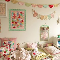 Thinking of doing something along the lines of the bunting with the name in Adeline's room. Maybe make the letters stand out a little more than in this room.