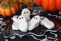 Nutter Butters are naturally ghost shaped, which make them perfect for dipping - Give them a bath in some almond bark and put on a couple of mini chocolate chips for eyes. And might I add that white chocolate covered Nutter Butters taste really good