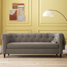 I love the simplicity of this couch. The neutral color would look great with some bright punches.