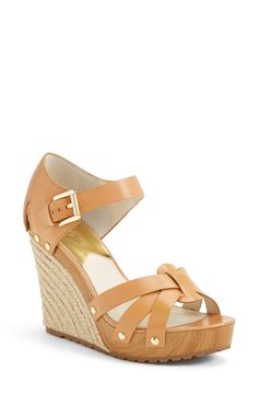 Cute for spring! Love these tan Michael Kors espadrille wedge sandals.
