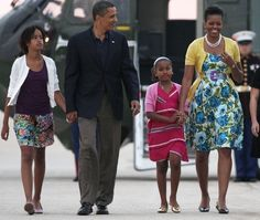 http://www.revelist.com/influencers/sasha-and-malia-obama-style/1013/Florals and bold colors for Malia and Sasha as they board Air Force One in 2009./5