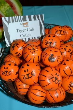 Zoo birthday party snacks: Tiger Cub Cuties. Mandarin oranges with Sharpie drawn faces and stripes