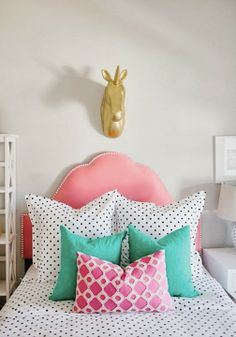 A bright and colorful girl's bedroom with gorgeous mixed print accent pillows.