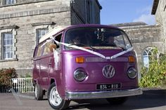 A wedding van. Purple WV decorated to  carry around the bride and groom. Fun idea for wedding. Irish wedding. Wedding photography by Kris McGuirk
