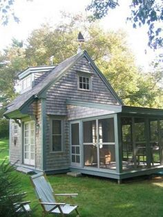 Traditional small cottage.  I especially like the screened porch.