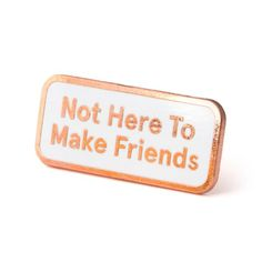 """I'm here to win Rose goldpin with whiteenamel Rubber backing Measures 1.25"""" wide"""