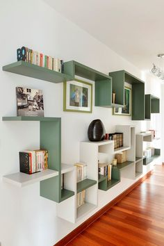 Meandering wall shelving in two colors makes every part of this wall lively and interesting.